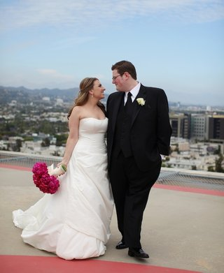 bride-in-strapless-gown-and-groom-in-black-tuxedo