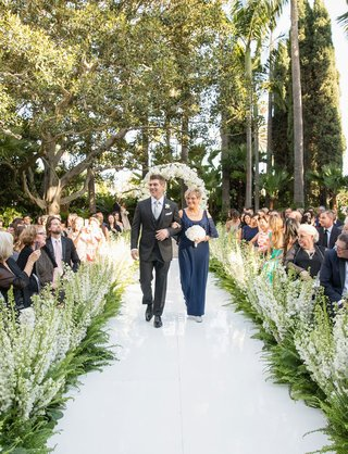 mothers-attire-mother-of-groom-in-navy-blue-dress-open-shoulder-detail-white-bouquet-guests-flowers