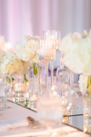 stemmed-glass-floating-candles-mercury-glass-mirrored-table-runner-all-white-decor-wedding