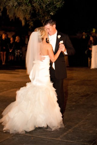 bride-and-groom-dancing-at-reception-in-wedding-attire