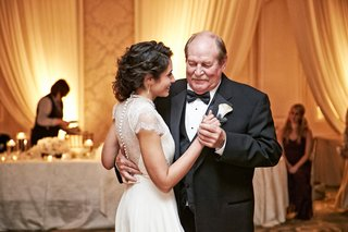 bride-in-an-jenny-packham-dress-with-lacy-sleeves-back-dances-with-father-in-black-tuxedo