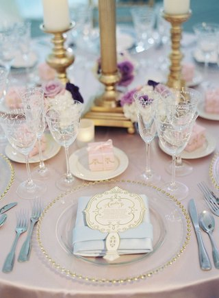 gold-beaded-charger-plate-with-light-blue-napkin-personalized-menu-card-and-pink-favor-box