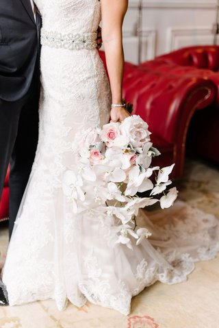 bride-in-lace-maggie-sottero-trumpet-gown-holding-bouquet-with-pink-peony-flowers-and-white-orchid