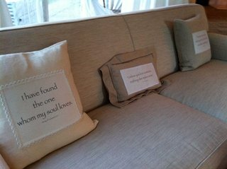 beige-couch-at-reception-with-bible-passages-printed-on-pillows-bible-passages-furniture