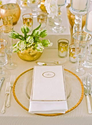 gold-candle-votives-vases-glasses-and-charger-at-wedding