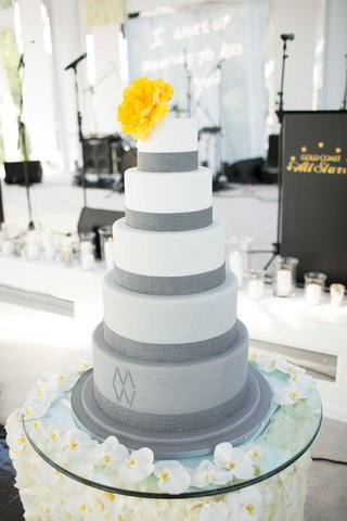 white-and-grey-fondant-cake-with-yellow-flower-cake-topper-orchid-table-display-cake-table