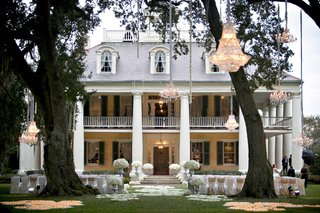 outdoor-wedding-ceremony-with-chandeliers-hanging-from-trees-at-houmas-house-plantation-in-louisiana