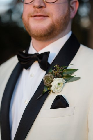 unique-boutonniere-ideas-boutonniere-with-a-white-ranunculus-scabiosa-pod-leaves