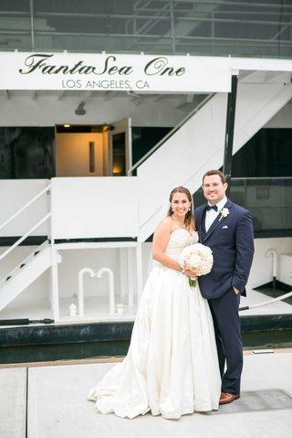bride-in-allure-ball-gown-groom-in-navy-joseph-abboud-suit