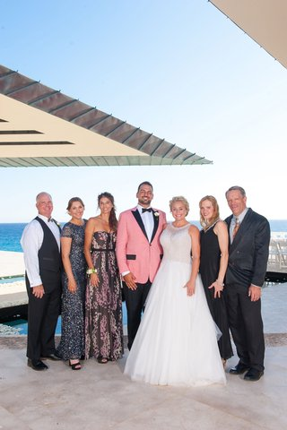 bride-in-mark-zunino-groom-in-salmon-suit-jacket-family-of-the-groom-portrait-blended-family