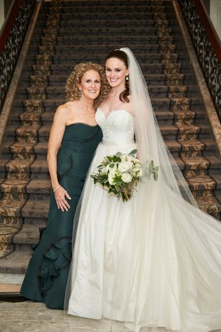 mother-of-bride-in-deep-forest-green-gown-strapless-with-bride-in-sweetheart-neckline-a-line-dress