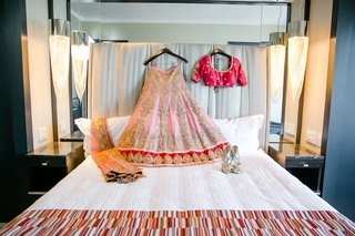 traditional-indian-bridal-dress-laid-out-on-bed