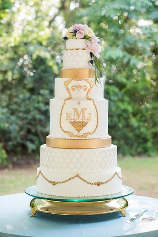 ornate-regal-wedding-cake-with-gold-details-and-fresh-flowers
