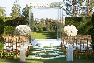 wedding-ceremony-grass-lawn-country-club-gold-chairs-white-flower-petal-aisle-runner-lucite-acrylic