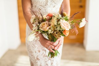 rustic-bridal-bouquet-with-roses-in-ivory-and-orange-and-grasses