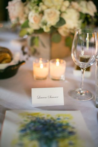ranch-wedding-reception-with-name-written-on-white-place-card-in-script