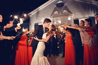 bride-in-ines-di-santo-wedding-dress-kisses-groom-at-sparkler-exit
