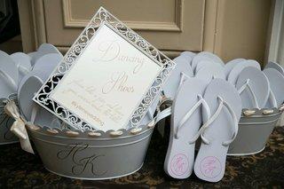 wedding-reception-wedding-favor-flip-flops-with-monogram-in-bucket-with-sign-reading-dancing-shoes