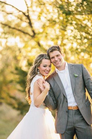newlyweds-in-semi-casual-wedding-attire-outside