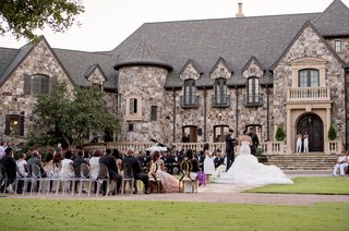 wedding-ceremony-on-lawn-guests-seated-in-the-round-large-private-estate-in-georgia-lawn-ceremony