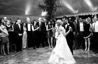 black-and-white-photo-of-bride-in-a-strapless-vera-wang-dress-dancing-with-groom-in-a-black-tuxedo