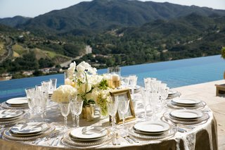 malibu-rocky-oaks-wedding-reception-by-infinity-pool-centerpiece-with-white-florals