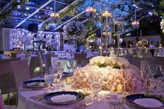 tent-wedding-reception-table-with-floating-candles-and-white-centerpiece