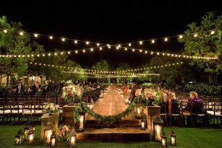 jewish-nighttime-wedding-ceremony-with-twinkle-lights-and-a-wooden-aisle
