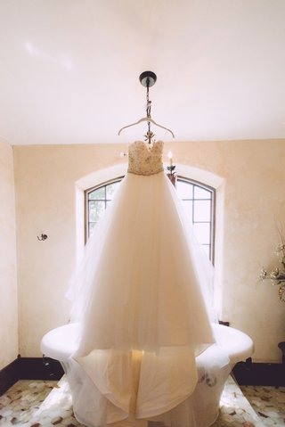 tara-keely-strapless-wedding-dress-in-front-of-bathtub