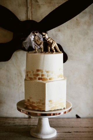 wedding-reception-hexagon-bottom-layer-round-top-layer-gold-dinosaur-bride-and-groom-cake-topper