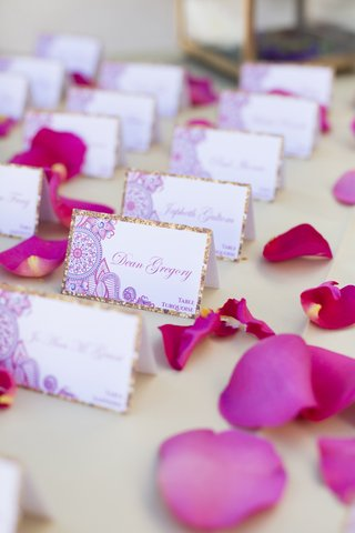 south-asian-wedding-detailed-escort-card-with-gold-border-pink-rose-petals
