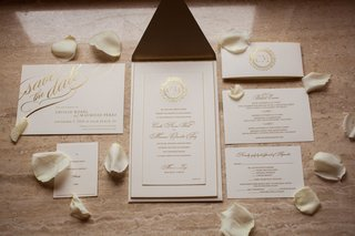 wedding-invitation-white-stationery-with-gold-lettering-gold-foil-cursive-calligraphy