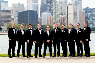 groomsmen-wear-tuxedos-with-pink-flower-boutonnieres-in-chicago