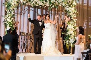 bride-and-groom-jewish-wedding-floral-canopy