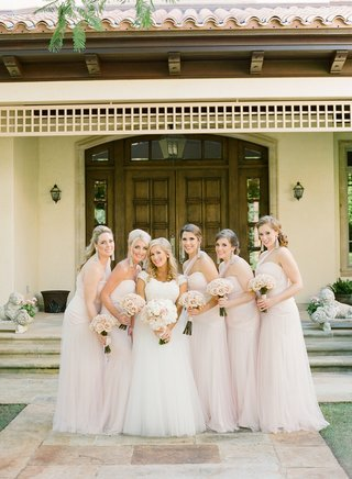 bride-in-a-monique-lhuillier-gown-with-bridesmaids