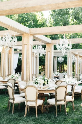 wedding-reception-jillian-murray-dean-geyer-outdoor-wedding-wood-structure-faux-rooms-wood-tables
