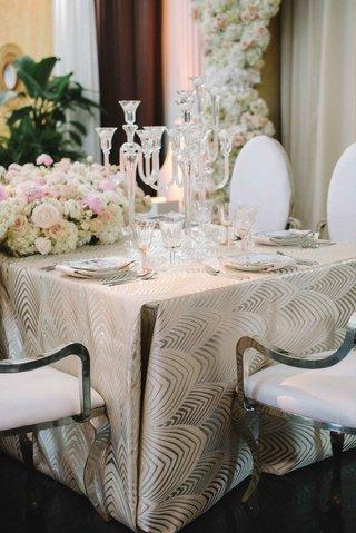 opulent-wedding-table-design-with-crystal-candelabra-hydrangea-rose-peony-ranunculus