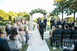 brides-father-escorts-her-to-groom-at-ceremony-dallas-country-club-green-manicured-lawn