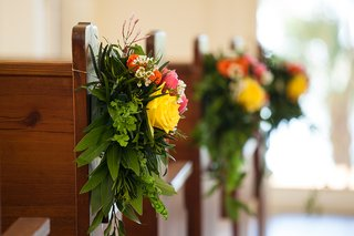 pew-church-wedding-aisle-decoration-chapel-green-leaves-yellow-pink-orange-flowers