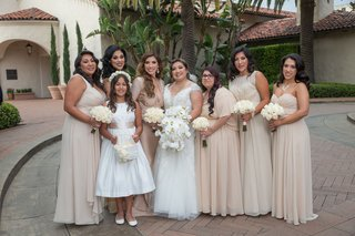 bride-in-wedding-dress-orchid-bouquet-bridesmaids-in-tan-taupe-champagne-mismatched-dresses