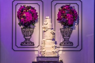 six-tier-wedding-cake-with-sugar-flowers-and-lace-patterned-like-the-bridal-gown