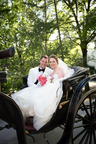 newlyweds-back-carriage-west-virginia-wedding-vera-wang-dress-white-tux-jacket-happy-love
