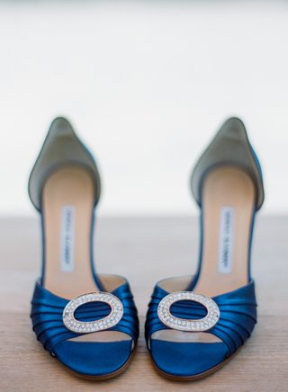 blue-manolo-blahnik-shoes-with-jeweled-brooch-on-front