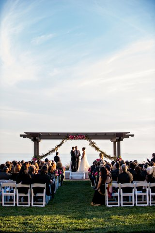 bride-and-groom-at-wedding-ceremony-on-lawn-of-terranea