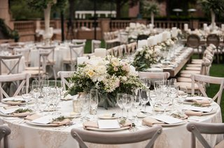 outdoor-wedding-reception-round-table-with-low-centerpiece-peony-ranunculus-greenery-rustic-elegant
