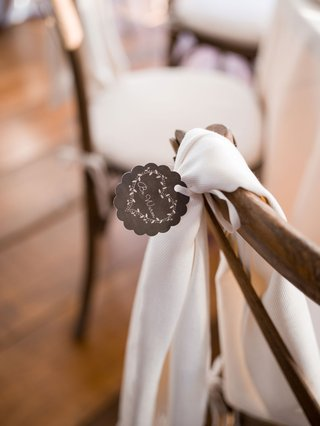 wedding-reception-favor-pashmina-shawl-on-back-of-x-back-wood-chair-with-stay-warm-tag-scallop