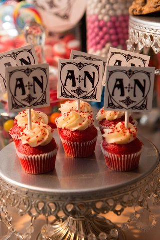 a-n-wedding-monogram-tags-on-top-of-red-cupcakes