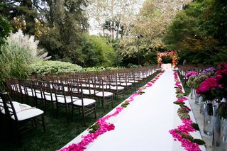 hotel-bel-air-swan-lake-wedding-ceremony-with-white-aisle-runner-and-bright-pink-flower-petals