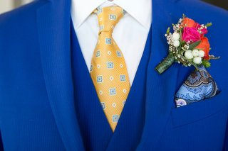 pink-and-orange-boutonniere-with-blue-suit-and-yellow-tie