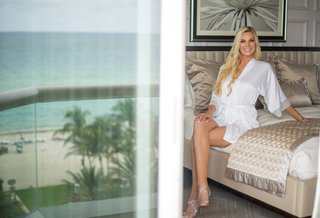 wedding-photo-of-bride-in-white-robe-high-heels-long-blonde-hair-acqualina-resort-and-spa-florida